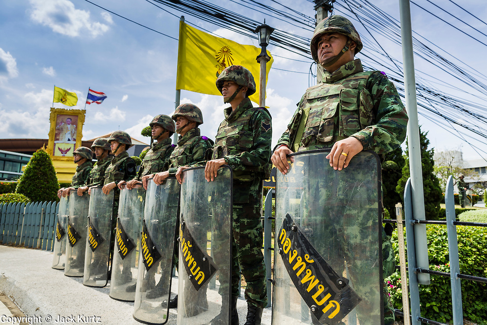 """20 MAY 2104 - BANGKOK, THAILAND:  Thai soldiers guard the Army Club, the venue for meetings between the Thai Army and civilian politicians after the army declared martial law. The Thai Army declared martial law throughout Thailand in response to growing political tensions between anti-government protests led by Suthep Thaugsuban and pro-government protests led by the """"Red Shirts"""" who support ousted Prime Minister Yingluck Shinawatra. Despite the declaration of martial law, daily life went on in Bangkok in a normal fashion. There were small isolated protests against martial law, which some Thais called a coup, but there was no violence.  PHOTO BY JACK KURTZ"""