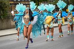 © Licensed to London News Pictures. 27/08/2018. LONDON, UK. Performers take part in The Grand Finale parade at the Notting Hill Carnival.  Over one million revellers are expected to visit Europe's biggest street party over the Bank Holiday Weekend in a popular annual event celebrating Caribbean culture.  Photo credit: Stephen Chung/LNP