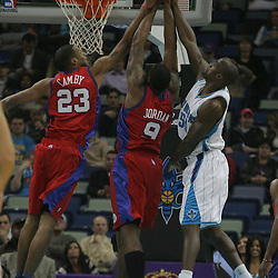 Jan 13, 2010; New Orleans, LA, USA; Los Angeles Clippers forward Marcus Camby (23) and center DeAndre Jordan (9) jump for a rebound with New Orleans Hornets center Emeka Okafor (50) during the first quarter at the New Orleans Arena. Mandatory Credit: Derick E. Hingle-US PRESSWIRE