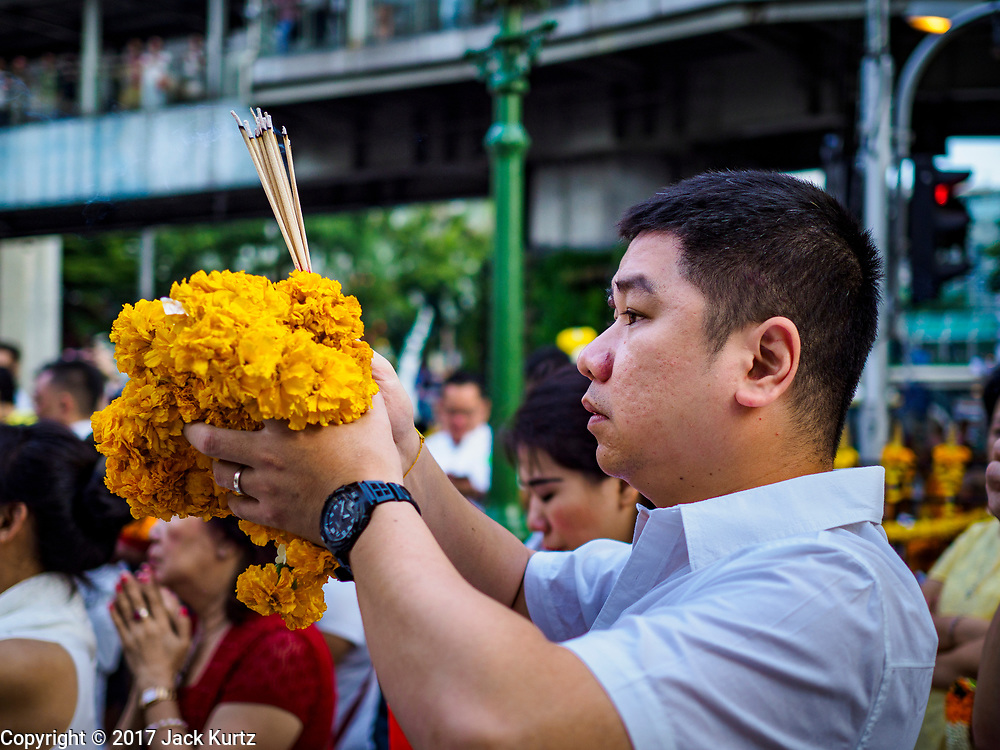 09 NOVEMBER 2017 - BANGKOK, THAILAND: People pray at the Erawan Shrine during a ceremony to mark the 61st anniversary of the shrine's dedication. The Erawan Shrine is one of the most popular shrines in Bangkok. It was dedicated on November 9, 1956, after a series of construction accidents at what was then the Erawan Hotel (since torn down and replaced by the Grand Hyatt Erawan Hotel). The statue in the shrine is Phra Phrom, the Thai representation of the Hindu god of creation Brahma. It is a Hindu shrine popular with Thai and Chinese Buddhists because it is thought that making an offering to the Phra Phrom will bring good fortune.    PHOTO BY JACK KURTZ
