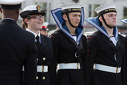 © licensed to London News Pictures. London, UK 20/10/2013. Sea Cadets uniforms are blown in the wind as they are inspected in Trafalgar Square for the 2013 Trafalgar Day Parade in London. The Royal Navy's annual event, Trafalgar Day marks Lord Nelson's victory at the Battle of Trafalgar. Photo credit: Vickie Flores/LNP