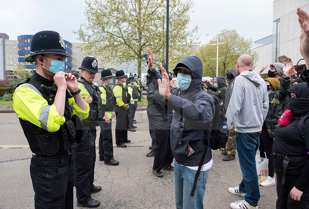 © Licensed to London News Pictures; 01/05/2021; Bristol, UK. Police block protesters from walking up Newfoundland Road leading to the M32 during a Kill the Bill protest protesting against the Police Crime Sentencing and Courts bill through the city centre on the evening of Mayday. This is the 11th Kill the Bill protest in Bristol since the first one on 21 March which saw violence and damage to the central Bridewell Police station and two police vehicles set on fire. Photo credit: Simon Chapman/LNP.