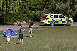 © Licensed to London News Pictures. 20/05/2020. London, UK. Police patrol as warm sunny weather hits Hampstead Heath, north London today as people get out of the house from coronavirus lockdown to relax, sunbathe or walk in the park.  Photo credit: Marcin Nowak/LNP