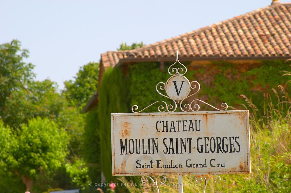 A white sign saying Chateau Moulin Saint Georges Saint Emilion Grand Cru Saint Emilion Bordeaux Gironde Aquitaine France