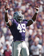 Kansas State defensive end Darren Howard (49) during game action against Texas A&M at KSU Stadium in Manhattan, Kansas in 1997.