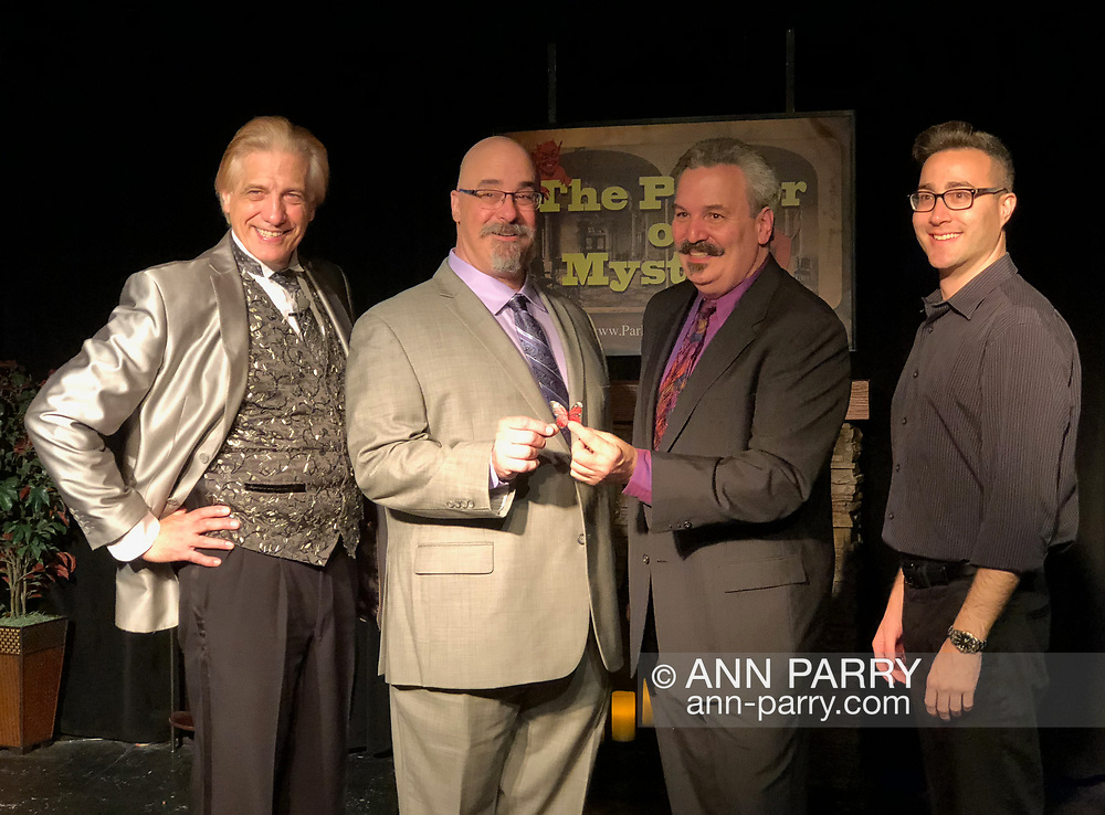 Lindenhurst, New York, USA. September 23, 2018. Magicians (L-R) RJ LEWIS, JOE SILKIE, BOB YORBURG, and DAVID ROSENFELD pose after performing in Comedy Magic Show presented by The Parlor of Mystery and South Shore Theatre Experience. Bob Yorburg, AKA Professor Phineas Feelgood, is a master wood carver and used unusual props in show. RJ Lewis, who sang song at start of his magic set, appeared in Broadway musical 'Barnum.' David Rosenfeld performed close-up magic and mentalism. Joe Silkie, the Parlor of Mystery producer, hosted show, and constructed and used custom magic props.