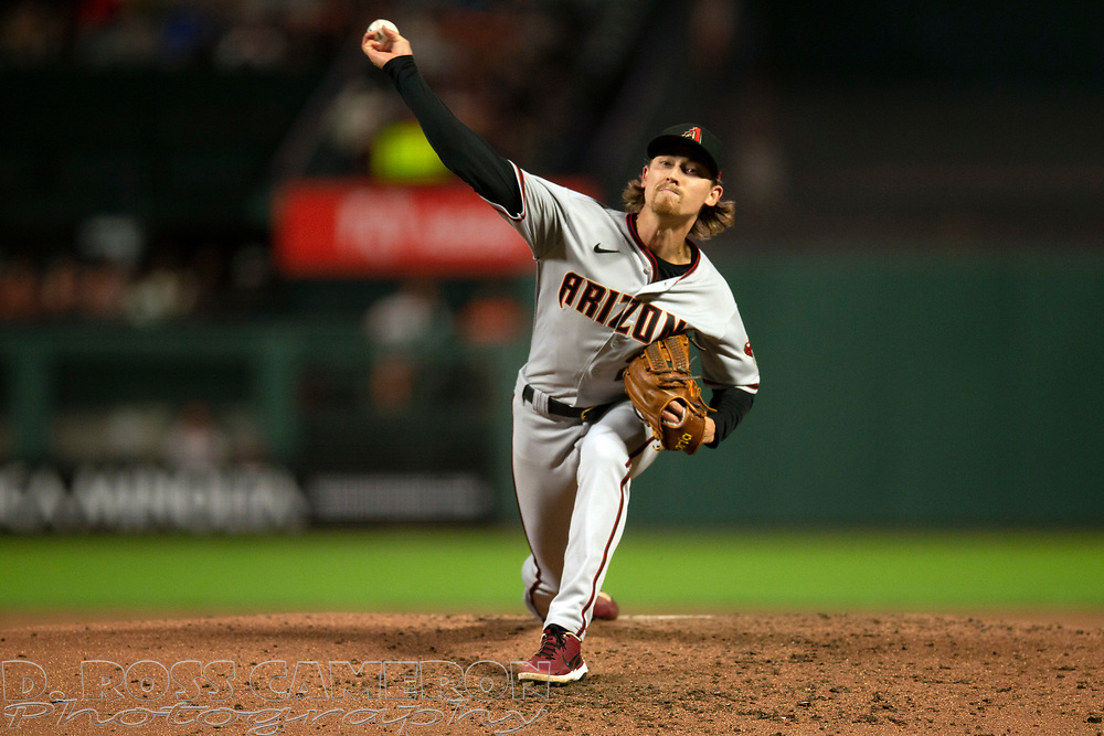 Arizona Diamondbacks starting pitcher Luke Weaver (24) delivers a pitch against the San Francisco Giants during the first inning of a baseball game, Tuesday, Sept. 28, 2021, in San Francisco. (AP Photo/D. Ross Cameron)