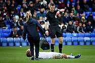 The Coventry trainer rushes on to help Coventry City midfielder Luke Thomas (23) who was eventually stretchered off during the EFL Sky Bet League 1 match between Peterborough United and Coventry City at London Road, Peterborough, England on 16 March 2019.