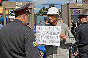"""Moscow, Russia, 11/06/2007..A demonstrator passing through a security check shows a policeman a poster which reads """"I am going to the march which does not agree with Putinism, polonium and riot police"""". Some two thousand opposition demonstrators gathered in central Moscow under the banner of the Other Russia movement led by Garry Kasparov and Eduard Limonov, leader of the banned National Bolshevik Party. A planned march was banned, and the demonstrators held a meeting in a central square instead."""