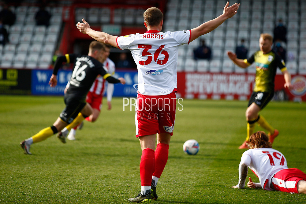 Luke Norris of Stevenage disputed a tackle from Barrow on Arthur Read of Stevenage during the EFL Sky Bet League 2 match between Stevenage and Barrow at the Lamex Stadium, Stevenage, England on 27 March 2021.