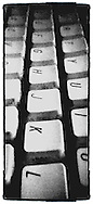 gritty monochrome keyboard closeup