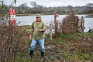 Ronnie Hamrick, former Formosa worker, picking up a mixture of new and legacy nurdles near Formosa's Point Comfort plant.