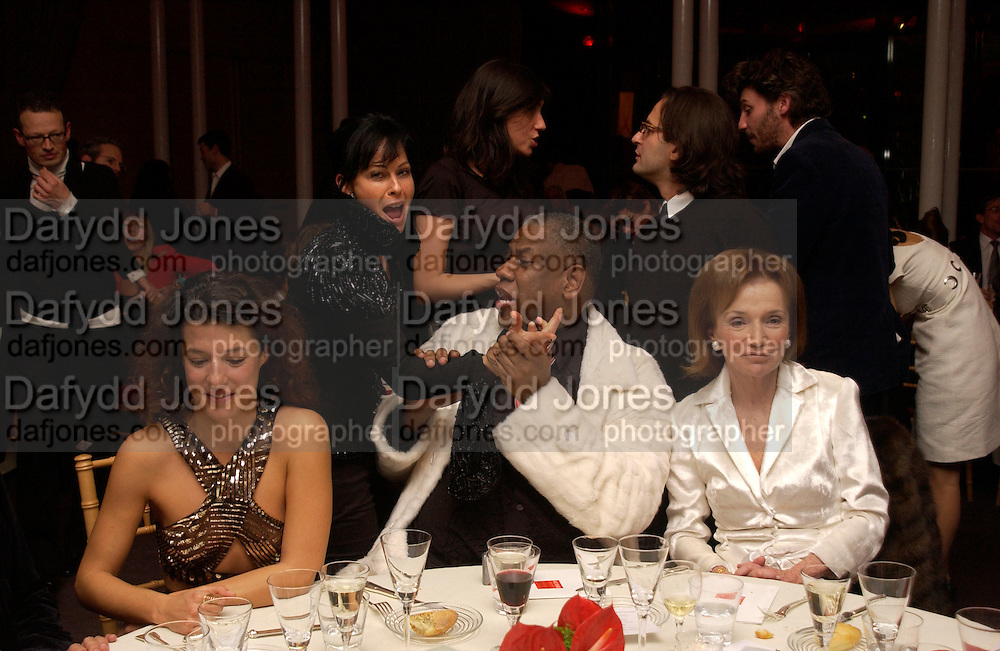 Camille Miceli, Andre Leon Talley, Lee Radiziwill, Amanda Harlech above,  Aids beneft during couture week, Pavilion D'Armee Nonville, 21 January 2004. © Copyright Photograph by Dafydd Jones 66 Stockwell Park Rd. London SW9 0DA Tel 020 7733 0108 www.dafjones.com