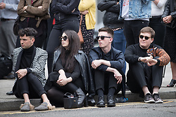 © Licensed to London News Pictures . 30/06/2017 . Stockport , UK . Crowds in the street outside the Town Hall watch the service on a big screen . The funeral of Martyn Hett at Stockport Town Hall . Martyn Hett was 29 years old when he was one of 22 people killed on 22 May 2017 in a murderous terrorist bombing committed by Salman Abedi, after an Ariana Grande concert at the Manchester Arena . Photo credit : Joel Goodman/LNP