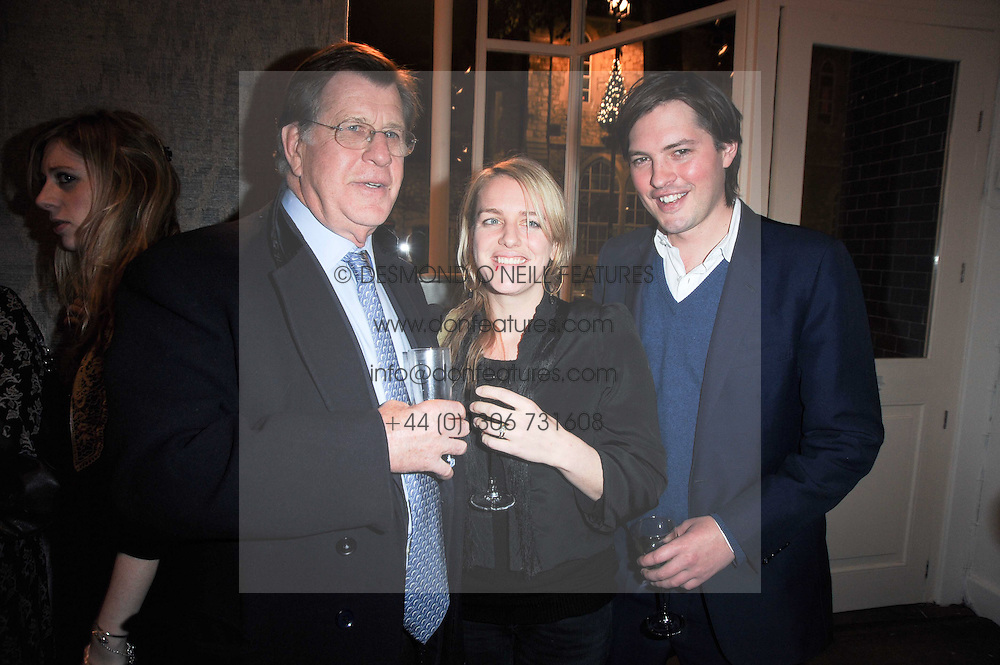 Left to right, SIMON ELLIOT and HARRY & LAURA LOPES she is the daughter of the Duchess of Cornwall at the opening of Luke Irwin's showroom at 22 Pimlico Road, London SW1 on 24th November 2010.