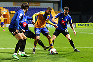 Jordan Bowery (9) of Mansfield Town is tackled by Connor Hall of Harrogate Town during the EFL Sky Bet League 2 match between Mansfield Town and Harrogate Town at the One Call Stadium, Mansfield, England on 24 November 2020.