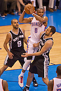 June 2, 2012; Oklahoma City, OK, USA; Oklahoma City Thunder guard Russell Westbrook (0) looks to make a pass under pressure from San Antonio Spurs guards Tony Parker (9) and Manu Ginobili (20).during a playoff game  at Chesapeake Energy Arena.  Thunder defeated the Spurs 109-103 Mandatory Credit: Beth Hall-US PRESSWIRE