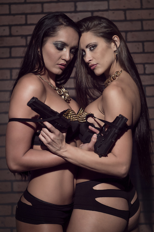Sensual girls in lingerie with weapons