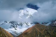 See the extinct volcano of Huascaran (22,205 feet), highest peak in Peru, in Huascaran National Park, Cordillera Blanca, Andes Mountains, South America. UNESCO honored Huascaran National Park on the World Heritage List in 1985. The Cordillera Blanca mountain range is in the Sierra Central of the Peruvian Andes.