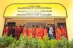 June 21, 2017 - Colombo, Sri Lanka - Sri Lankan Buddhist monks supporting the Buddhist nationalist group Bodu Bala Sena (BBS) gather inside the Colombo Fort magistrates court premises where Sri Lankan monk Galabodaatte Gnanasara's case was being heard by court on Wednesday 21 June 2017.....The  general Secretary of BBS, Ven. Galagodaatte Gnanasara Thero surrendered himself following a arrest warrant issued by court for alleged hate crime against Muslims.   Gnanasara thero obtained bail afterwards. (Credit Image: © Tharaka Basnayaka/NurPhoto via ZUMA Press)