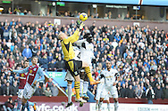 Aston Villa's goalkeeper Aston Villa's Brad Guzan  is under pressure from Swansea City's Chico Flores and Wilfried Bony during the Barclays Premier league, Aston Villa v Swansea city at Villa Park in Birmingham, England on Saturday 28th Dec 2013. <br /> pic by Jeff Thomas, Andrew Orchard sports photography.