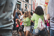 Young adults dance on the street during a festival in the city of León, Spain. (June 23, 2018)<br />
