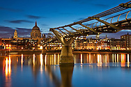 Millenium Bridge over the River Thames looking towards St Paul's Cathederal at dawn, London, Uk