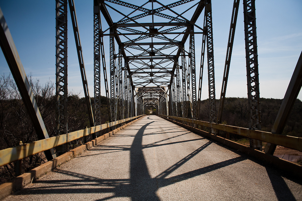 A bridge over the Brazos River built in the 1930's affords a view downstream where Goodnight and Loving gathered their herds at the Neuhaus Pens for their first drive.