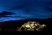The Potala Palace, ancestral home of the Dalai Lamas, the spiritual Leaders of Tibet, at dusk.