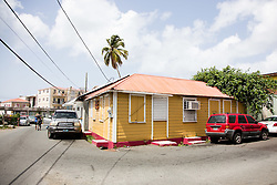 Houses typically found in the Savan area include vernacular buildings made out of lapboard that would house one or more families.  The Virgin Islands Economic Development Association Enterprise & Commercial Zone Commission hosts a historical tour through the Savan (Savanne) neighborhood.   St. Thomas, US Virgin Islands.  9 July 2015.  © Aisha-Zakiya Boyd
