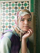 A girl photographed in her school, in the medina of Fes, Morocco