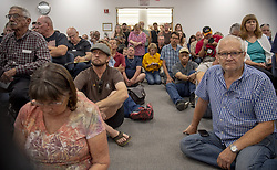 July 31, 2018 - Clearlake, California, U.S. - Displaced by the two fires in Lake County, the public listens as emergency responders give updated information on Tuesday morning, July 31, 2018 at the Clearlake City Council. Chambers. Mendocino Complex fires had burned 90,212 acres by Wednesday morning, Cal Fire said. (Credit Image: © Jose Luis Villegas/Sacramento Bee via ZUMA Wire)