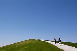 Family walking along path on Play Mountain in Moerenuma Park in Sapporo Japan 2005