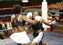 Judy Nyaguthi (L) and Consolata Msanda both from Kenya exchange blows during their Mac Series Professional Boxing Bonaza at Safaricom Indoor Arena in Nairobi on November 5, 2016. Judy won Photo/Fredrick Onyango/www.pic-centre.com (KEN)