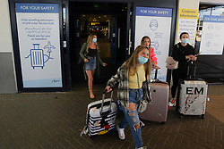 © Licensed to London News Pictures. 04/06/2021.Manchester, UK. . Passengers arrive from a Faro flight at Terminal 1 of Manchester airport. From 4am on Tuesday 8 June, Portugal will be removed from the Green list and added to the Amber list. Photo credit: Ioannis Alexopoulos/LNP