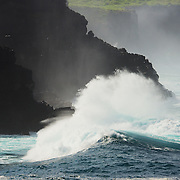 Waves and water breaking on the cliffs of Espanola Island, Galapagos, Ecuador, South America.