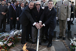 French-Armenian singer Charles Aznavour lights the flame at the tomb of the unknown soldier beneath the Arc de Triomphe on April 24, 2010 during a ceremony to commemorate the 95th anniversary of Armenians genocide in 1915. Photo par Stephane Lemouton/ABACAPRESS.COM