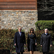 CHARLOTTE NC - MARCH 2, 2018: President Donald Trump and First Lady Melania Trump with Vice President Mike Pence and Second Lady Karen Pence attend the funeral of Reverend Dr. Billy Graham under a large tent that was temporarily erected in front of the Billy Graham Library in Charlotte, NC. The evangelist died in his home in Montreat, NC 10 days earlier. After a 3 hour long motorcade to Charlotte, his body lied in repose for two days before lying in honor under the rotunda of the United State Capitol building in Washington DC. His body will be laid to rest next to his wife Ruth at a private internment ceremony.  CREDIT: LOGAN CYRUS/ AFP