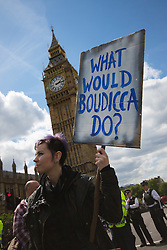 """ter, London, May 30th 2015. Anti-austerity campaigners bring traffic on Westminster Bridge as they paint and hang a banner off the bridge highlighting an alleged £120 billion owed in taxes as compared to the proposed £12 billion cuts to welfare. PICTURED: A woman asks """"What would Boudicca do?"""""""