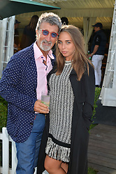 EDDIE JORDAN and CHLOE GREEN at the Laureus Polo held at Ham Polo Club, Ham, Richmond, Surrey on 18th June 2015.
