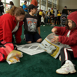 Stacey Rivas (cq) of San Francisco and her children Vincente Rivas (cq), 8, and Sofia Rivas (cq) 5, look through a FanFest guide during the 2007 DHL All-Star FanFest, Saturday, July 7 at Moscone Center West in San Francisco...Photo by David Calvert/MLB.com