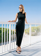 This photo was created for a local fashion mailorder catalog. Our blonde model is enjoying the Florida sunshine in a long, black, skintight dress.