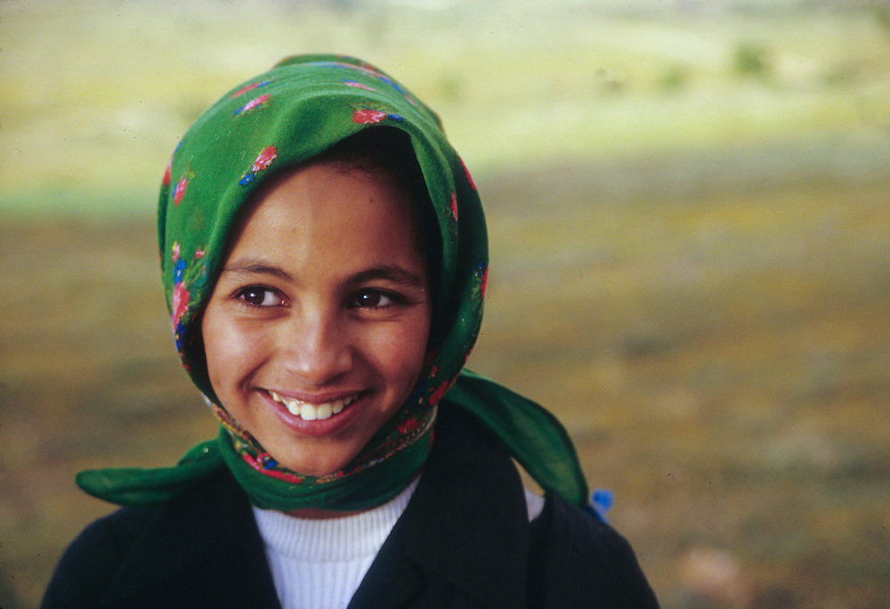 Africa, Morocco, Tiznit, girl in field wearing head scarf