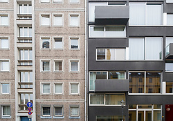 Contrast between old east German era apartment building and new luxury apartment building on Linienstrassse in gentrified Mitte district Berlin Germany