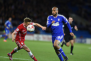 David McGoldrick of Ipswich Town ® tries to go past Cardiff's Craig Noone. Skybet football league championship match, Cardiff city v Ipswich Town at the Cardiff city stadium in Cardiff, South Wales on Tuesday 21st October 2014<br /> pic by Andrew Orchard, Andrew Orchard sports photography.