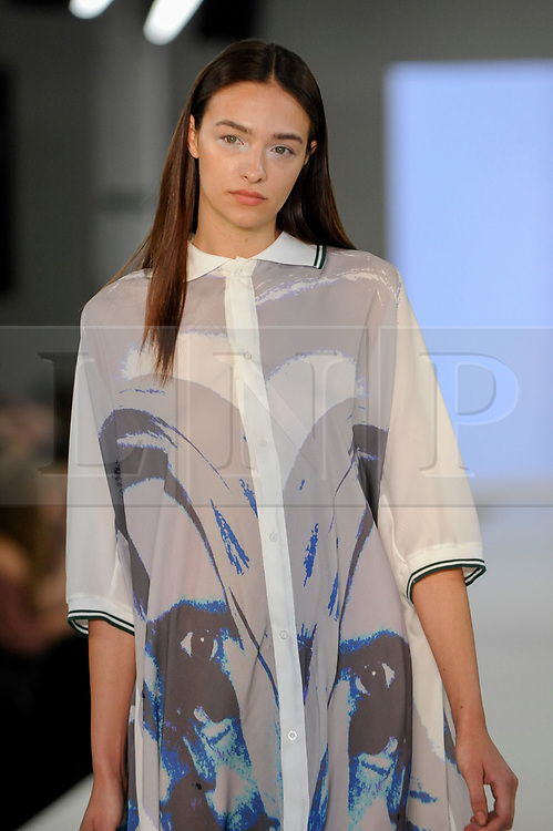 © Licensed to London News Pictures. 05/06/2017. London, UK. A model presents a look by Nicole Thomas from The Arts University Bournemouth on the second day of Graduate Fashion Week taking place at the Old Truman Brewery in East London.  The event showcases the graduation show of up and coming fashion designers from UK and international universities. Photo credit : Stephen Chung/LNP