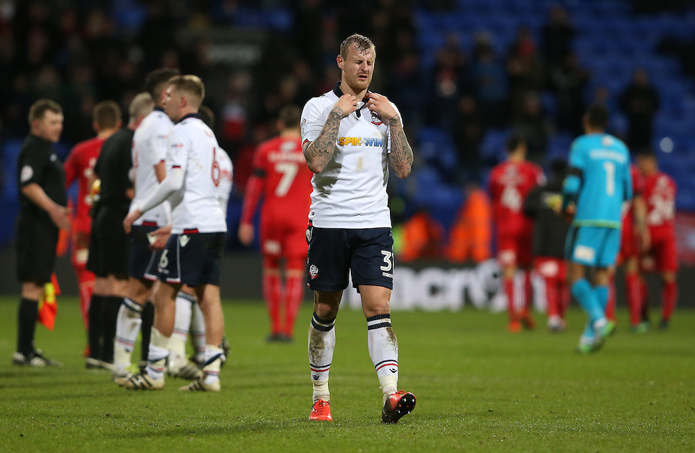 Bolton Wanderers' David Wheater shows his dejection at the final whistle after his team lost 2-1 after leading 1-0<br /> <br /> Photographer Stephen White/CameraSport<br /> <br /> The EFL Sky Bet League One - Bolton Wanderers v Swindon Town - Saturday 14th January 2017 - Macron Stadium - Bolton<br /> <br /> World Copyright © 2017 CameraSport. All rights reserved. 43 Linden Ave. Countesthorpe. Leicester. England. LE8 5PG - Tel: +44 (0) 116 277 4147 - admin@camerasport.com - www.camerasport.com