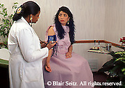 doctor, physician at work African-American Physician Examines Hispanic Patient,