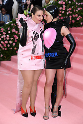 """Lena Dunham and Jemima Kirke at the 2019 Costume Institute Benefit Gala celebrating the opening of """"Camp: Notes on Fashion"""".<br />(The Metropolitan Museum of Art, NYC)"""