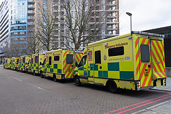 © Licensed to London News Pictures. 02/01/2021. London, UK. A fleet of ambulances are parked outside The Excel Centre, East London. The centre was converted into a Nightingale hospital treating Covid-19 patients during the first pandemic in April 2020 and is on standby. A surge of Covid-19 cases is expected next week following the Christmas holidays. Photo credit: Ray Tang/LNP